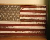 """Made entirely out of reclaimed barn wood, this American Flag measures 31""""l x 20""""h x 2"""" d."""