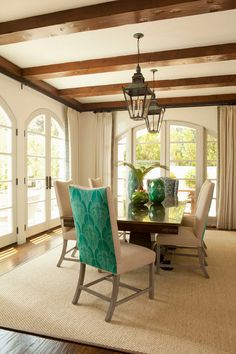 Neutral tones with a pop of turquoise on the back of the dining room chairs...Bonesteel Trout Hall #diningroom #turquoise #color
