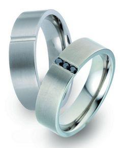 Trauringe Charlotte  Titanringe   Damenring mit 3 Diamanten, 0,06 kt, Farbe: schwarz,   Ringbreite: 5,50 mm,  Ringhöhe: 2,10 mm,  Oberfläche: mattiert
