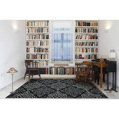 A medium-sized home library with white tiles flooring matching the white walls and white bookshelves lighted by a couple of wall lighting. Home Design, Home Library Design, Home Office Design, Design Ideas, Library Ideas, Cozy Home Library, Mini Library, Workplace Design, Design Concepts
