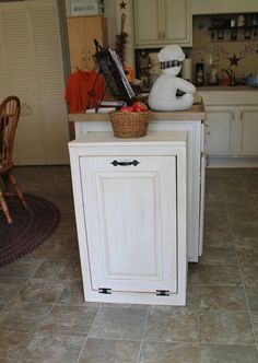 Wooden Tilt out Trash Can - Trash Bin - Wood Trash Box - Cabinet to hide Trash - Kitchen Garbage - Tip out trash can - Kitchen Laundry Room or Bathroom.  Im so excited to have added this new item to my product line. I have had so many requests for these to match my lovely Vegetable Bins and Bread boxes. (check my other listings out) What a great way to hide your nasty trash can as well as have useful space on top. Our special tilt out design allows the door to open easily but stops before…
