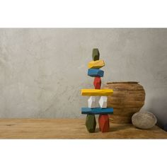 Areaware's Balancing Blocks are carved out of oak to resemble faceted stones and colored with water-based paint for safe, colorful play for kids and kids at heart.