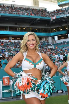 Check out all our Miami Dolphins merchandise! Dolphins Cheerleaders, Hottest Nfl Cheerleaders, Football Cheerleaders, Cheerleader Girls, Cheerleading, Cute Cheer Pictures, Professional Cheerleaders, Promo Girls, Ice Girls