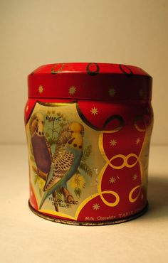 Raspberry red budgerigarsRaspberry red by lettuceTURNIPtheBEET, $10.00  Raspberry red budgerigars.Raspberry red Vintage Kemps biscuit tin.Printed four panels. BIRD TIN antique vintage mauve red raspberry pink