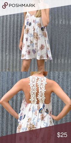 Floral, crochet back dress This floral dress is gorgeous and perfect for summer! Crochet, lace in the back and soft material. Fully lined Dresses Mini