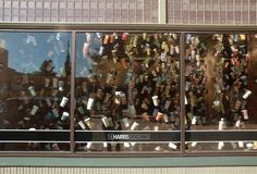 Exterior view of 1001 Coffee Cup Stories, morning, at the Harris Building, 111 South Division. Vote Code: 56642