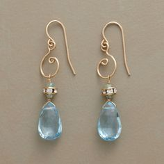 DESIGNER: THOI VO Aquamarines and Swarovski crystals covet balcony seats overlooking blue topaz divas. Golden swirls recall musical clefs beneath French wires. Handmade in USA byThoi Vo SEE DETAILS HERE: LYRIC OPERA EARRINGS