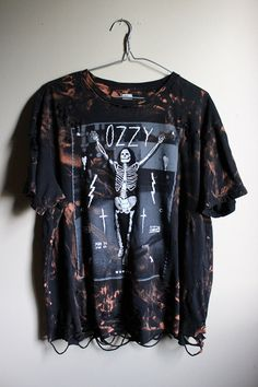 This shirt is a one of a kind, each splattered shirt is different.  This one is a black Ozzy Skeleton tee, thin cotton jersey.  This shirt has has…