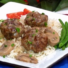 Try This Flavorful New Take On Meatballs As An Entree Or Appetizer: The meatballs are a mixture of pork sausage, chuck ground beef, sweet onions, garlic, and herbs which are simmered with baby portobello mushrooms. The resulting incredibly rich gravy is to die for. It's a perfect topper for normally bland white rice, pasta noodles, or couscous.