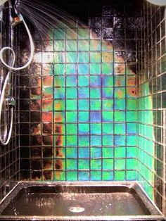 Northern Lights- Color Changing Tiles_ Black at room temperature and changed color with the water temperature. How crazy would that be with a multi-colored LED shower head? lol!