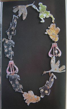 Schiaparelli's Zodiac necklace with silver metal polychromatic symbols including two silver birds, two blue wolves , two purple men, two pink harps & yellow hair 1938, Jean Clement For Schiaparelli (From The Billyboy Paris Collection)