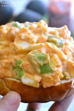 Sriracha Egg Salad {Skinny Recipe}: 4 hard boiled eggs, 1/4c plain yogurt, 1/2 avocado, 1T Sriracha sauce, 1/8tsp garlic salt
