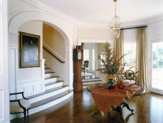 Robert A.M. Stern Architects - Dream House for This Old House Magazine ~ Beautiful floors and varied levels and a center hall table in this entry ~