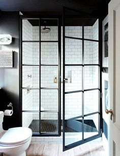 shower doors that look like french doors! so much cozier than clear glass bathroom