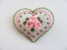 Really pretty heart broach.I love the flowers especially. So different looking.