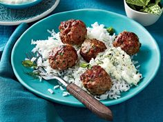 Greek Meatballs with Cucumber-Yogurt Sauce and Rice Recipe   This easy recipe makes enough meatballs for two meals – one comforting supper of meatballs and hot rice, and another meal of meatball pitas with cucumber-yogurt sauce. You may also make a batch of meatballs and freeze them, reheating as many as you need for a meal. The cucumber-yogurt sauce is a hard-working multi-tasker, flavorful enough to be used for a dip with cut vegetables, or drizzled over baked chicken or fish.