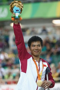 Gold medalist Guihua Liang of China celebrates on the podium at the medal ceremony for Men's 3km C2 Pursuit  Final on day 2 of the Rio 2016 Paralympics at Rio Olympic Velodrome on September 9, 2016 in Rio de Janeiro, Brazil.