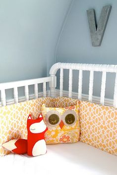 Nursery color palette:  Light smokey blue wall.   White crib and trim.  Accent colors: Red, Yellow, Pear Green, White, Black, Gray.