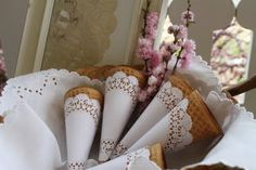 doily ice cream cones.  If you decide on gelato or ice cream these are precious.  I have about 500 doilies my mom gave me but maybe tea stain them.  This seems like just the crazy kind of project I'd do.