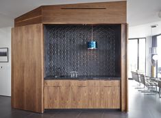 ANN SACKS® Ogassian field tile   The door on the stand-alone walnut bar can be closed when it's not being used.