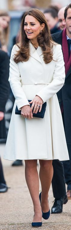 Kate Middleton's white tailored coat proves she's always perfectly polished.