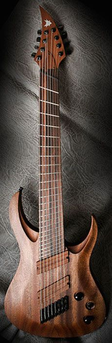 Ran Guitars - Crusher FF8 model: gorgeous dark red wood eight string guitar with curved V headstock. RESEARCH by #DdO:) - INSTRUMENTS FOR JOY -https://www.pinterest.com/DianaDeeOsborne/instruments-for-joy/ - Made in Olsztyn, #Poland. TWO scale lengths/ 24 frets gives balanced string tension, response, sound clarity, better intonation, excellent ergonomics. ABM single saddles, custom Merlin pickups / wooden covers. Photo pinned via Emma Califf's #Instruments I'd like to possess #PINTEREST…