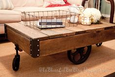 DIY Factory Cart Table. Tutorial here http://theblissfulbeeblog.blogspot.com/2012/05/factory-cart-table-diy-restoration.html#