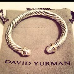 david yurman.  my signature pieces. I stack 2 bracelets on each side of my Yurman timepiece.