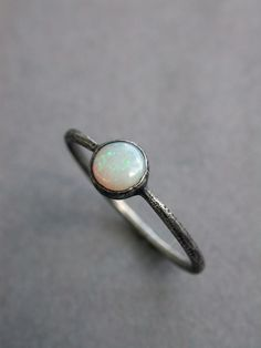 LOVE opals. Would be perfectly happy if this was my engagement ring someday.