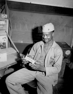 Pfc. Luther Woodward, a member of the Fourth Ammunition Company, admires the Bronze Star awarded to him for `his bravery, initiative and battle-cunning.' The award was later upgraded to the Silver Star. April 17, 1945