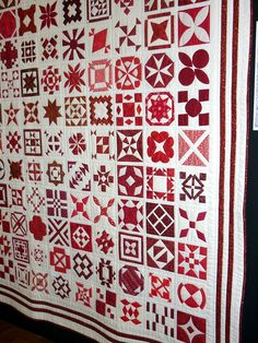 Red and white Dear Jane quilt with unusual border, 2013 Australian Quilters Association show. Photo by Linda Bear at Pin Money Quilts
