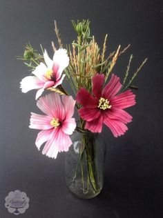 These were supposed to be cosmos, but the petal shape is far too rectangular, however I thought they still made quite a nice posy with the grasses. The buds and leaves of the cosmos are made out of flower paste too and were very fiddly and...