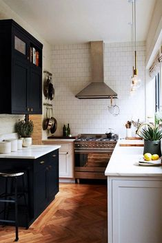 Floor to ceiling tiles and black/white cabinets.