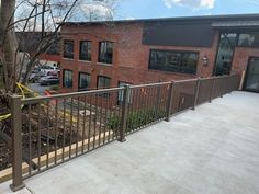 Bronze ornamental aluminum high railing set in concrete walk at this apartment complex in Bethlehem, installed by Skip & Ray from Fence Styles, Apartment Complexes, Bethlehem, Concrete, Deck, Bronze, Wood, Outdoor Decor, Home Decor