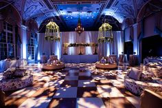 Blue Lighting at Enchanted Reception | Photography: Lauren Ross Photography & Nancy Cohn Photography. Read More: https://www.insideweddings.com/weddings/sophisticated-breakers-wedding-with-pink-florals/335/