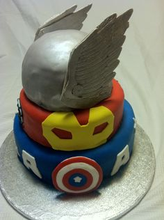 From the bottom:  Captain America, Ironman and Thor.  Birthday cake for a super 4 year old. :)