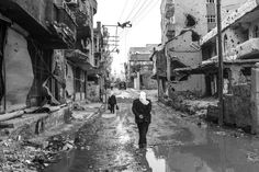 A man walks in the ruins in Cizre, Turkey. The city was badly damaged during the clashes between Turkish security forces and the Kurdish PKK militants, Cizre, Turkey, March 2016.