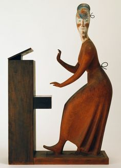 Woman at the Piano, 1920-24, de Elie Nadelman, escultura em madeira (MoMA)