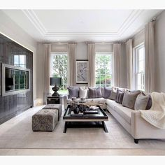 An elegant family room by The L&C Company