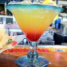 Tropical Sunrise Margarita! Hornitos® Reposado Tequila (100% Blue Agave), DeKuyper® melon liqueur, pineapple juice & a splash of grenadine.
