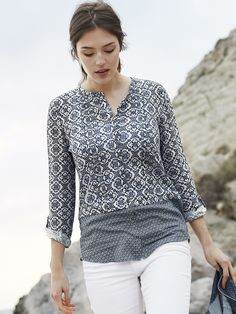 White Stuff - Regatta Linen Jersey Shirt (Navy) - Oh how we love a linen jersey shirt. This one's a stunner, in a collarless style, with a beautiful all-over print and contrasting woven hem. There's a full row of little dark bronze buttons down the front, and roll-tab sleeves for versatility.  Composition: Main: 100% Linen, Other: 100% Viscose Care: Machine Washable  Size 12 high shoulder neck point to hem approx. 68cm  415864_NAVY