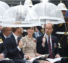 hrhduchesskate:  100th Anniversary of the Battle of the Somme, Opening of the new Thipval Museum, France, July 1, 2016-Prince Harry and the Cambridge hold umbrellas for a brief rain that fell during the event