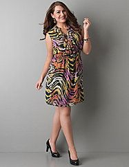 Feminine with a wild touch, our animal print chiffon dress defines a curvy figure with a smocked waist and ruffled notch neckline.  Sheer print chiffon tops a solid sheath liner with lace-trim V-neck. lanebryant.com