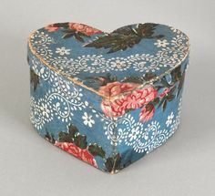 """Pennsylvania heart-shaped wallpaper box, mid 19th c., with floral decoration on a blue ground, 4"""" h., 6 3/4"""" w."""