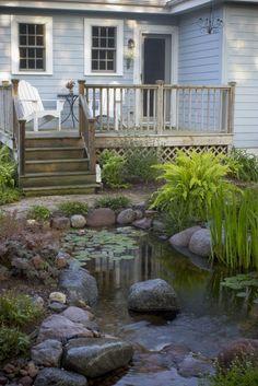 Outdoor living on a deck next to a water garden