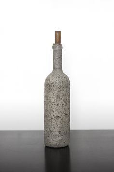 "jamesprorok: "" Cast concrete wine bottle with turned walnut cork. """