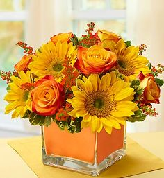 Modern Enchantment™ for Fall: bi-color yellow #roses and brilliant #sunflowers accented by red solidago and fresh greens.