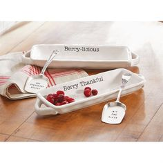 """Mud pie cranberry dish set. 2-piece set. Ceramic serving dish features double handles, debossed """"Berry Thankful"""" or """"Berry-licious"""" sentiments and comes with """"HIT THE SAUCE"""" or """"GET CRANBERRY SAUCED"""" silverplate stamped server."""