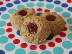 Two childhood favorites collide for a delicious new favorite! Peanut Butter and Jelly Oatmeal Thumbprint Cookies!