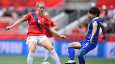 OTTAWA, ON - JUNE 07: Isabell Herlovsen of Norway challenges Duangnapa Sritala of Thailand during the FIFA Women's World Cup 2015 Group B match between Norway and Thailand at Lansdowne Stadium on June 7, 2015 in Ottawa, Canada. (Photo by Lars Baron - FIFA/FIFA via Getty Images)